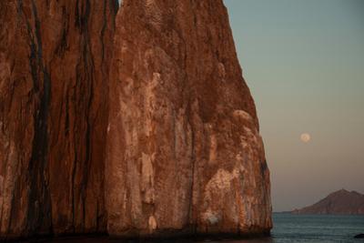 Moonrise Above Sleeping Lion Rock Off San Cristobal in the Galapagos by Karen Kasmauski
