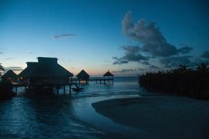 Resort Cottages at Sunset on Bora Bora by Karen Kasmauski