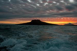 The Channel Between Sombrero Chino Island and Santiago Island in the Galapagos at Sunset by Karen Kasmauski