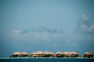 Vacation Cottages over Water on Bora Bora by Karen Kasmauski