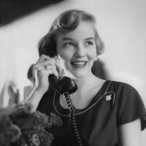 Vogue - August 1953 - Woman Talking on Telephone by Karen Radkai