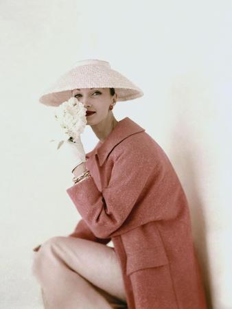 Vogue - March 1956 - Model Evelyn Tripp wearing pink ensemble