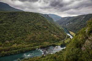 Bend In The Una River From Bosnia Side. River Spans Border Between Bosnia, Herzegovina & Croatia by Karine Aigner