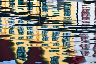 Buildings Reflected in Ripples in a Harbor
