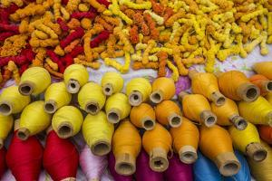 Famous Ecuador Otavalo Market with Colorful Rolls of Ecuadorian Thread by Karine Aigner