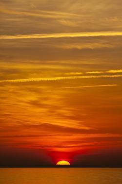 Orange Sunrise on the Water of the Bay on Tilghman Island, Maryland by Karine Aigner