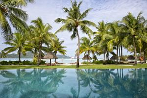 Palm Trees Reflect In The Pool At The Four Seasons Bora Bora by Karine Aigner