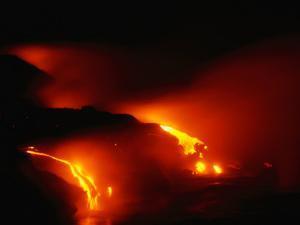 Molten Lava Cascading into Pacific Ocean During Eruption of Kilauea Volcano, Hawaii, USA by Karl Lehmann