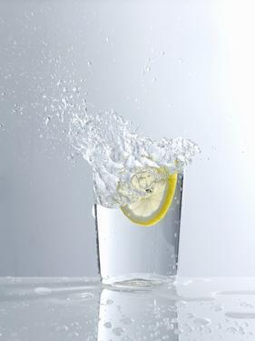 Water Splashing Out of a Glass by Karl Newedel