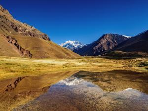 Aconcagua Mountain reflecting in the Espejo Lagoon, Aconcagua Provincial Park, Central Andes, Mendo by Karol Kozlowski