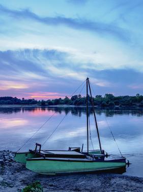 Boat and Vistula River at sunset, Mecmierz near Kazimierz Dolny, Lublin Voivodeship, Poland by Karol Kozlowski