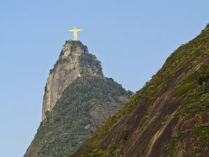 Christ the Redeemer statue on top of the Corcovado Mountain viewed from Santa Marta, Rio de Janeiro by Karol Kozlowski