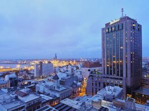 Elevated view of the City Centre with the characteristic building of the Radisson Hotel, Montevideo by Karol Kozlowski