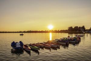 Pedalos at Firlej Lake at sunset, Lublin Voivodeship, Poland by Karol Kozlowski