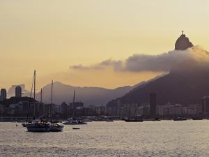 Sunset over Botafogo Bay and Corcovado Mountain viewed from Urca, Rio de Janeiro, Brazil, South Ame by Karol Kozlowski