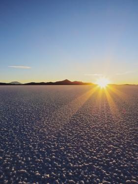 Sunset over the Salar de Uyuni, the largest salt flat in the world, Daniel Campos Province, Potosi  by Karol Kozlowski