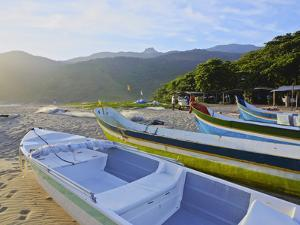 Traditional colourful boats on the beach in Bonete, Ilhabela Island, State of Sao Paulo, Brazil, So by Karol Kozlowski