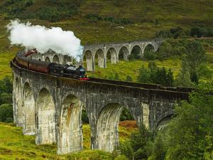 UK, Scotland, Highlands, Jacobite Steam Train crossing the Glenfinnan Viaduct. by Karol Kozlowski