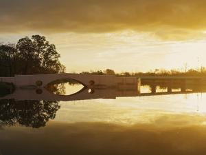 View of the Areco River and the Old Bridge at sunset, San Antonio de Areco, Buenos Aires Province,  by Karol Kozlowski