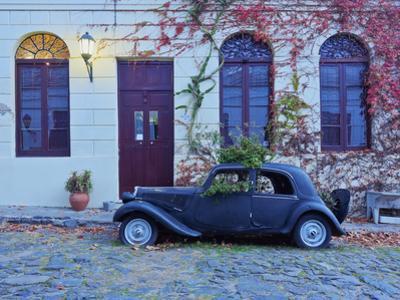 Vintage car on the cobblestone lane of the historic quarter, Colonia del Sacramento, Colonia Depart by Karol Kozlowski