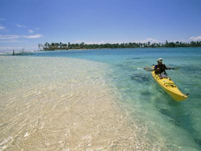 A Person Goes Kayaking in the Sea