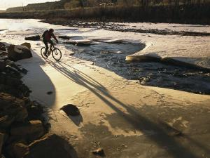 Winter Bicycling on the Partially Frozen Dolores River by Kate Thompson
