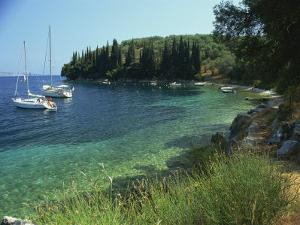 Yachts Moored Offshore in Kalami Bay on the Coast, Corfu, Ionian Islands, Greek Islands, Greece by Kathy Collins