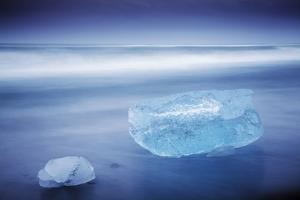 Iceland, Jokulsarlon. Frozen Icebergs Washed Up on the Black Beach at Jokulsarlon. by Katie Garrod