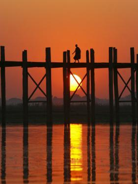 Myanmar (Burma), Amarapura, Taungthaman Lake, U Bein's Bridge, a Monk Walking Home at Sunset by Katie Garrod