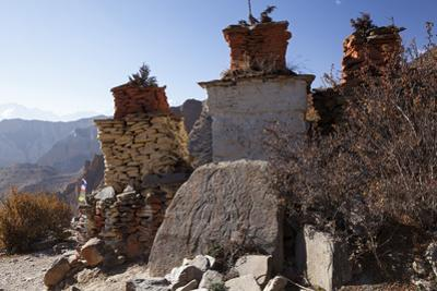 Nepal, Mustang. Chortens and an Ancient Stone Carving En Route Between Samar and Giling.