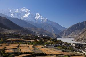 Nepal, Mustang, Kagbeni. the Soaring Peak of Nilgiri Behind the Village of Kagbeni. by Katie Garrod