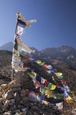 Nepal, Mustang. Prayer Flags Fluttering at Dajori La Pass, High Up Above the Village of Samar. by Katie Garrod