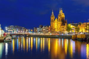 Night Amsterdam Canal and Basilica Saint Nichola by kavalenkava volha