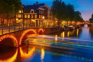 Night City View of Amsterdam Canal and Bridge by kavalenkava volha