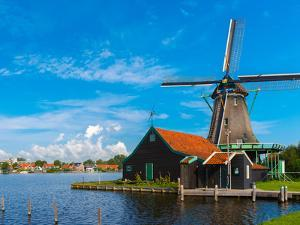 Windmills in Zaanse Schans, Holland, Netherlands by kavalenkava volha