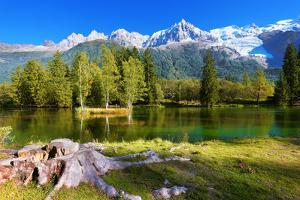 City Park in the Alpine Resort of Chamonix. Cold Lake Surrounded by Trees and Snow-Capped Mountains by kavram
