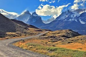 Midday Landscape in the National Park Torres Del Paine; Chile. the Gravel Road is Bent between Yell by kavram