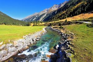 National Park Krimml Waterfalls in Austria. Headwaters of Waterfalls - a Narrow Fast Roiling River by kavram
