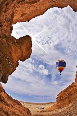 The Balloon Flies above a Picturesque Slot-Hole Canyon in Desert by kavram