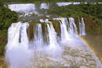The Best-Known Falls in the World - Iguazu. the Magnificent Rainbow Costs over Roaring Water Stream