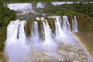 The Best-Known Falls in the World - Iguazu. the Magnificent Rainbow Costs over Roaring Water Stream by kavram