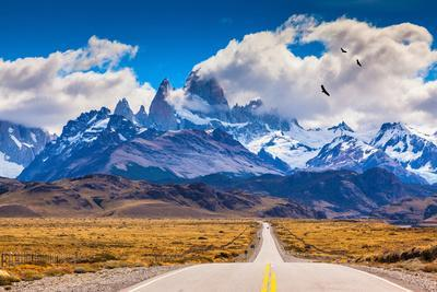 The Highway Crosses the Patagonia and Leads to Snow-Capped Peaks of Mount Fitzroy. over the Road Fl