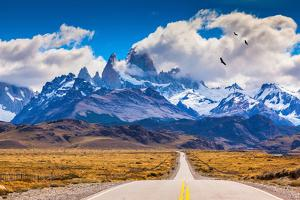 The Highway Crosses the Patagonia and Leads to Snow-Capped Peaks of Mount Fitzroy. over the Road Fl by kavram