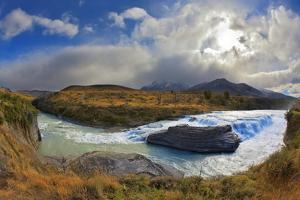 The Majestic Cascading Waterfall - Cascades Paine. National Park Torres Del Paine in Southern Chile by kavram