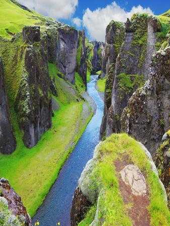 The Most Picturesque Canyon Fjadrargljufur and the Shallow Creek, Which Flows along the Bottom of T