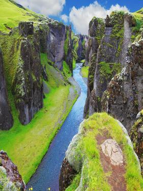 The Most Picturesque Canyon Fjadrargljufur and the Shallow Creek, Which Flows along the Bottom of T by kavram