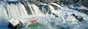 Kayaker descending waterfall, Great Falls, Potomac River, Montgomery County, Maryland, USA