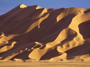 Vehicle and Large Sand Dune by Kazuyoshi Nomachi