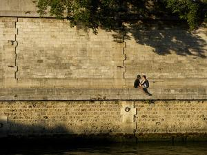 A Couple Sitting on the Bank of the Seine River by Keenpress