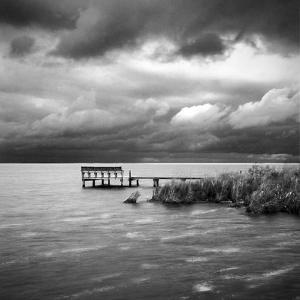 A Dock on the Bay with a Storm Approaching in the Outer Banks by Keith Barraclough